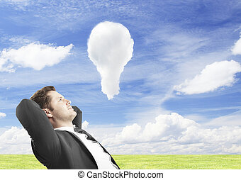 clud lamp in sky - businessman sitting and looking at clud...