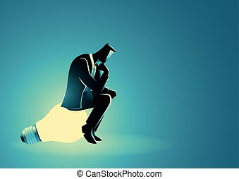Businessman sitting and thinking on light bulb
