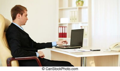 Businessman sitting at a desk