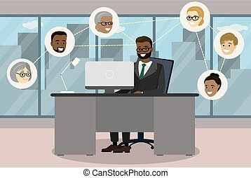 Businessman sitting at desk in modern office and communicating in social networks
