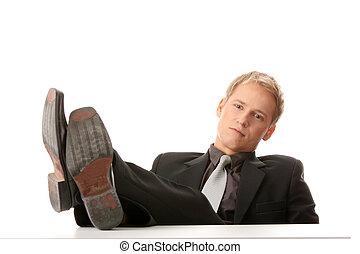 Businessman sitting at desk,