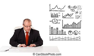 businessman sitting at desk with statistics and graphs, ...