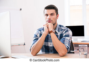 Businessman sitting at the table in office