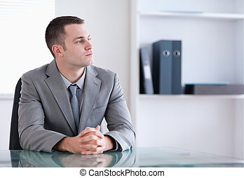 Businessman sitting behind a table