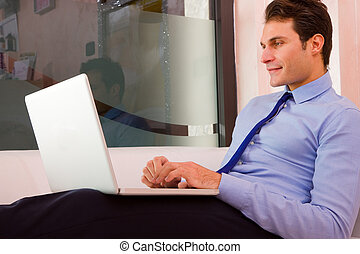 Businessman sitting couch using laptop