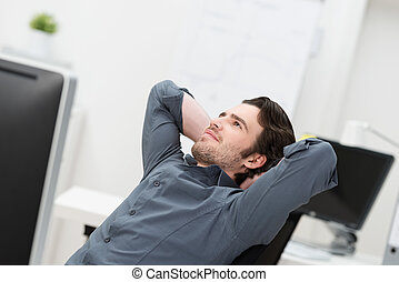 Businessman sitting daydreaming