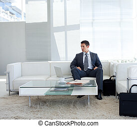 Businessman sitting in a waiting room