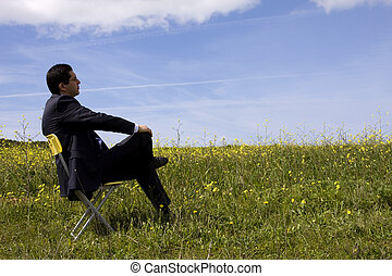 Businessman sitting in a yellow chair