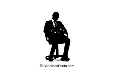 Businessman sitting in an armchair and thinking about his promotions White background. Silhouette