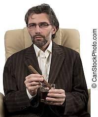 businessman sitting in chair with cigar