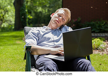 Businessman sitting in garden