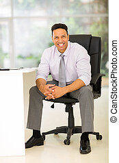 businessman sitting in modern office