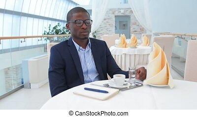 Businessman sitting in restaurant