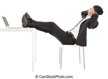 businessman sitting on a chair to take a rest