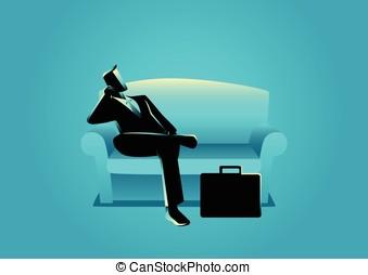 Businessman sitting on sofa