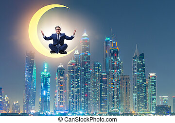 Businessman sitting on the crescent moon