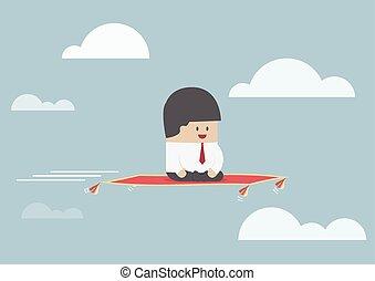Businessman sitting on the flying carpet