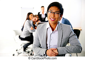 Businessman sitting on the office chair in front of business meeting