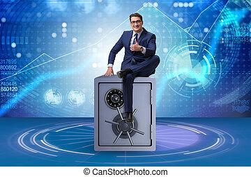 Businessman sitting on top of safe