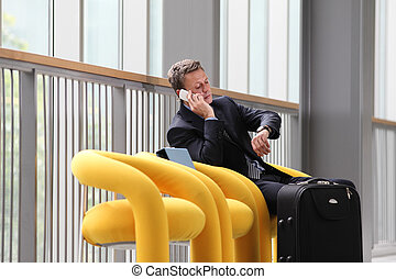 businessman sitting talking on the phone
