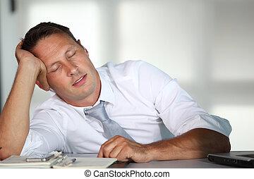 Businessman sleeping at his desk