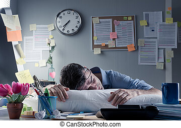 Businessman sleeping in the office overnight - Exhausted...