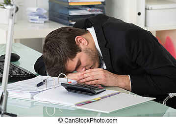 Businessman Sleeping With Invoice On Desk