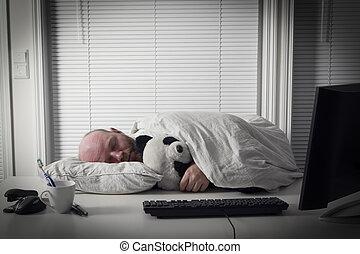 Businessman Sleeps in Office