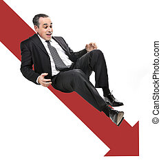 Businessman sliding down red arrow in financial crisis