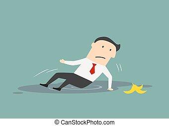 Businessman slipped on a banana