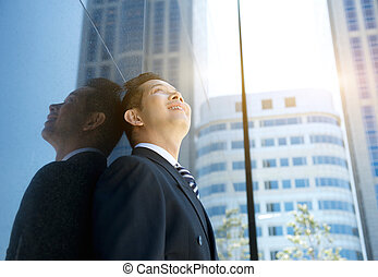 Businessman smiling and looking up