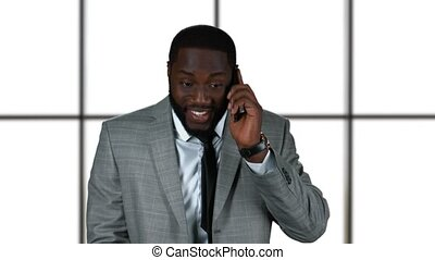 Businessman smiling and phone talking.