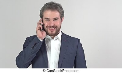 Businessman smiling and talking on the phone