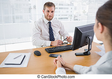 Businessman smiling at camera in his office