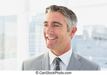 Businessman smiling at his office