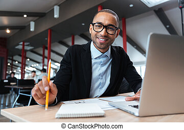 Businessman smiling at the working place