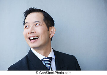 Businessman smiling on gray background