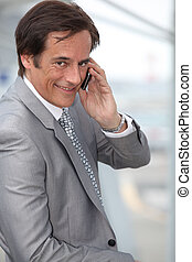 Businessman smiling on mobile phone
