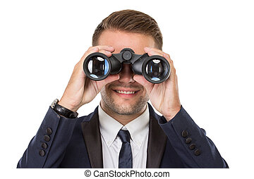 Businessman smiling while using a binocular