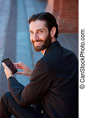 Businessman smiling with cell phone