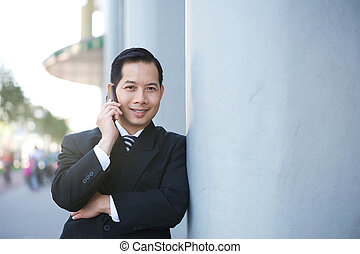 Businessman smiling with cellphone