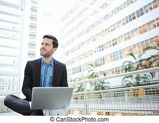 Businessman smiling with laptop