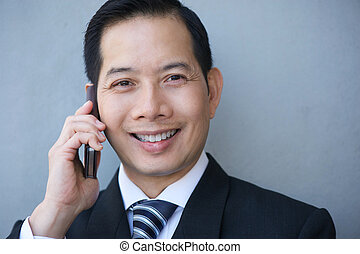 Businessman smiling with mobile phone