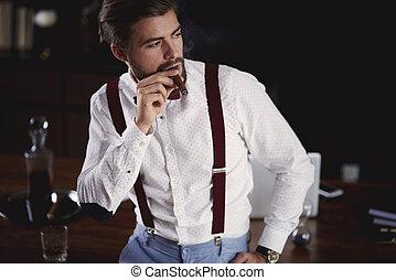 Businessman smoking a cuban cigar