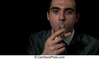 Businessman smoking his cigar on b