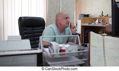 Businessman smoking in the office