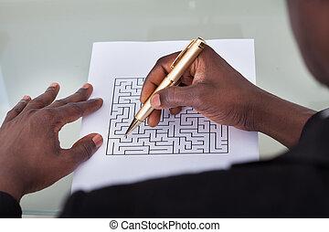 Businessman Solving Maze Puzzle