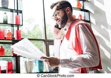 Businessman Speaking by Phone in Sunlight