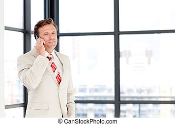 Businessman speaking on a phone with copy-space