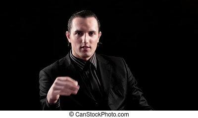 businessman speaking on black